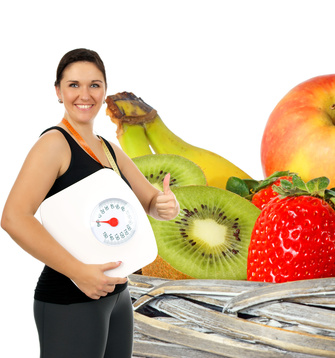 young woman with a weight scale and fresh fruit